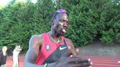 Lopez Lomong signs autographs after competing in 1500m
