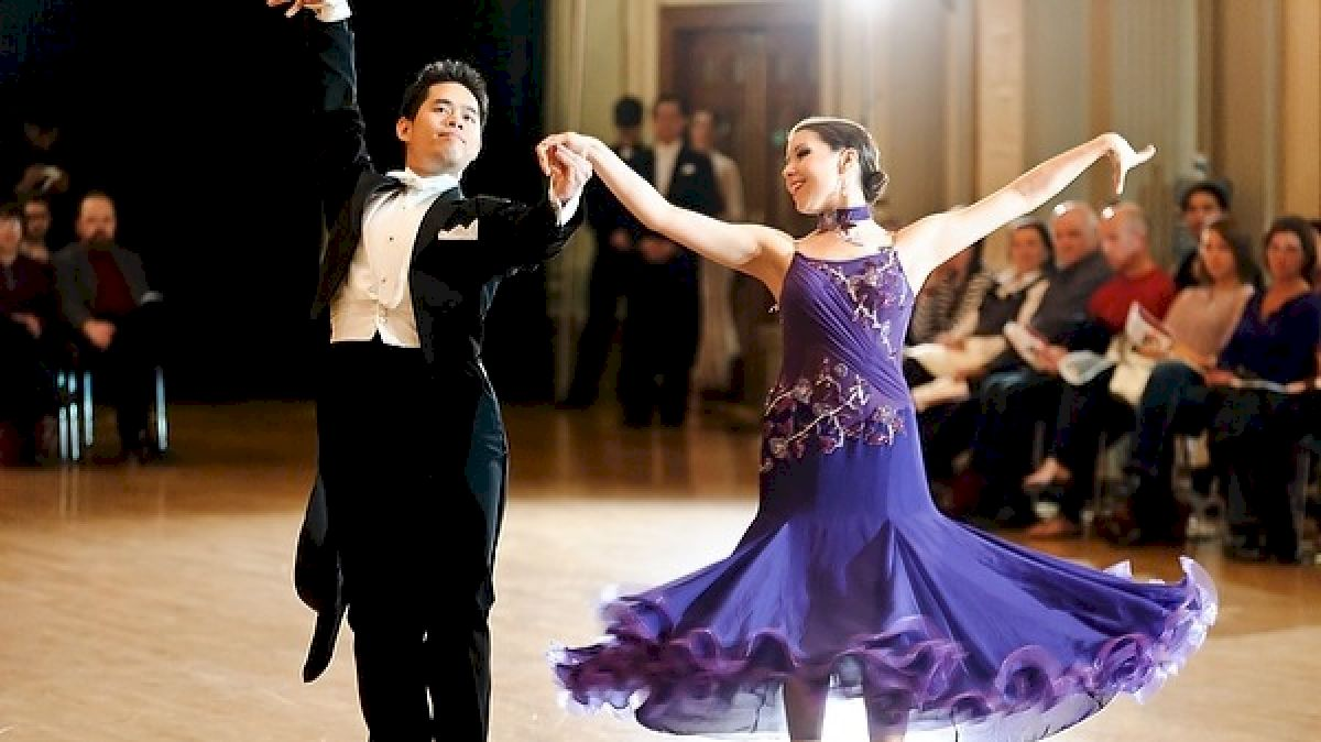 Dancers dancing in a ballroom dance competition