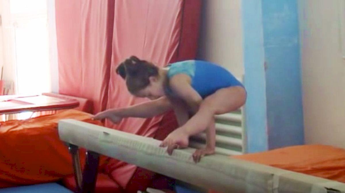Legendary Gymnastics TBT: Watch Andreea Iridon Do 115 Presses In A Row