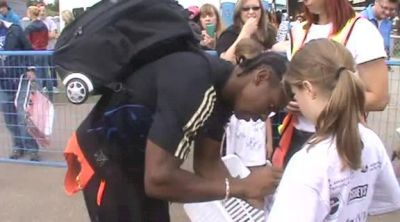 Winner Yohan Blake after his race with the fans