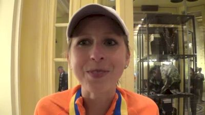 Hilary Dionne after finishing 15th, holding Meb's hand